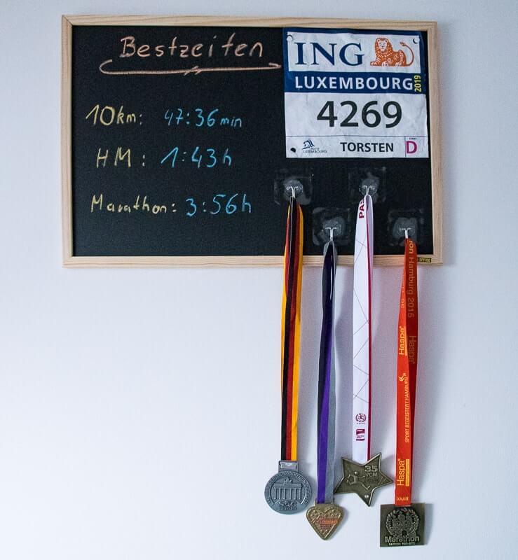 Bestzeiten Board als Medaillenhalter